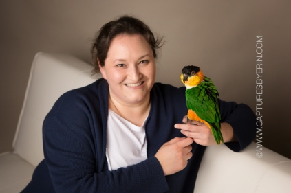 Holly & one of her companion parrots, Ravi the black-headed caique.
